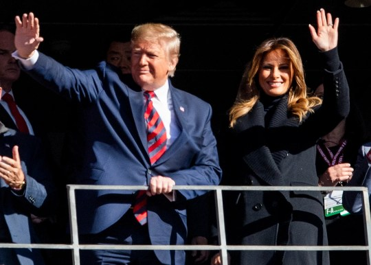 President Donald Trump and First Lady Melania Trump wave during the first quarter of the Alabama vs. LSU game  at Bryant-Denny Stadium in Tuscaloosa, Ala., on Saturday November 9, 2019.