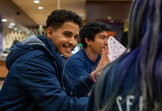 Everett Alvarez High School Interact Club members gather at Natividad to celebrate fundraising $19,000 for The Wendy Baker RN Memorial Fund on Nov. 14, 2019. Dr. James Lew (white jacket), Wendy Baker's husband, received the donation.