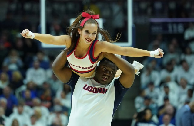 Nov. 17: The Connecticut Huskies cheerleading team performs during a break in the action against the Florida Gators in the second half at Harry A. Gampel Pavilion.