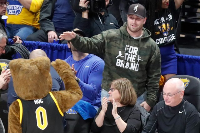 Dec. 3: Pittsburgh Steelers quarterback Devlin Hodges greets the Pittsburgh Panthers Mascot
