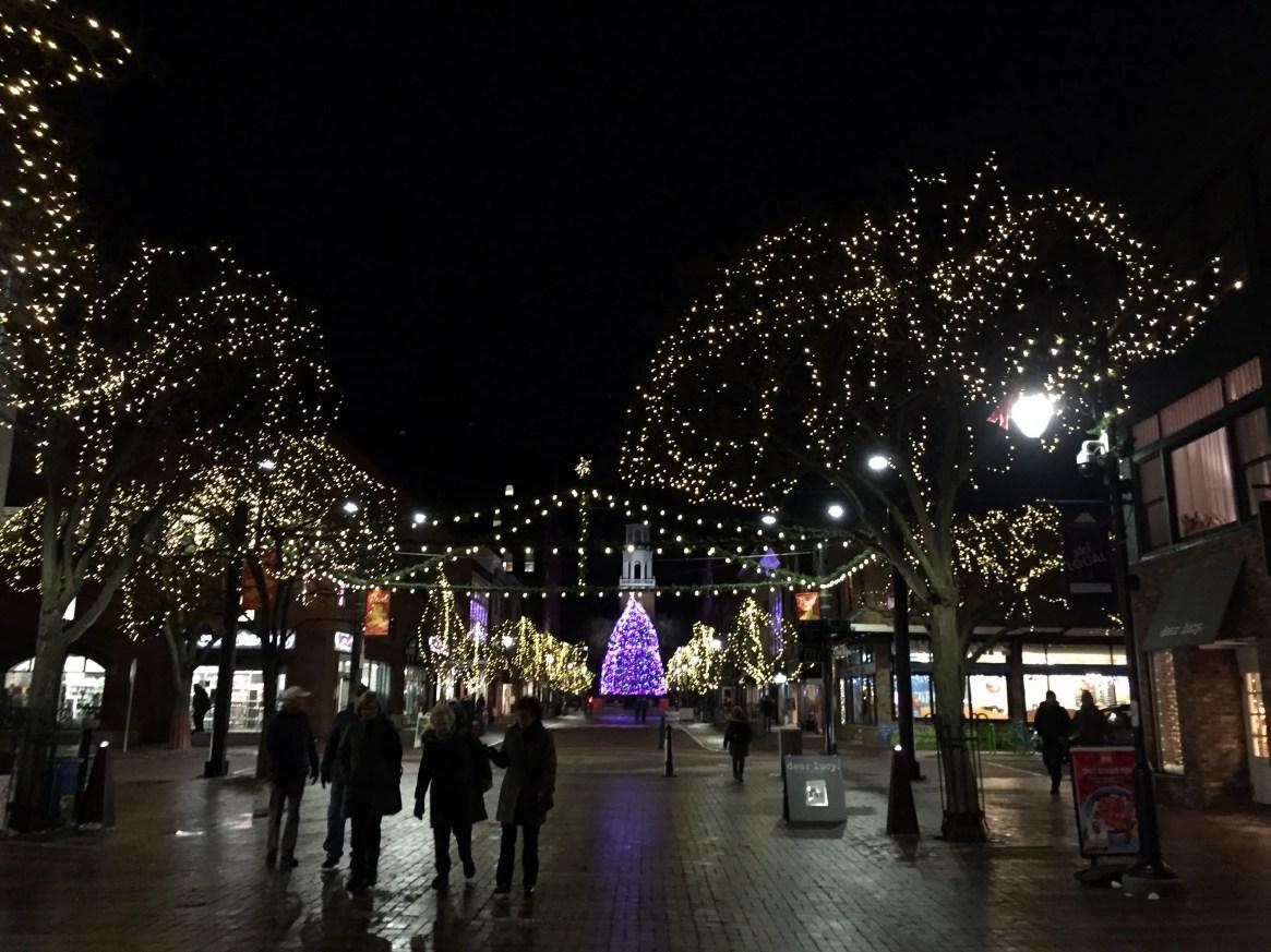 Pedestrians enjoy holiday lights on Burlington's Church Street Marketplace on Dec. 4, 2019.