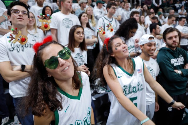 Dec. 8: Michigan State fans cheer during the game against Rutgers in East Lansing, Mich. Michigan State won. 77-65.