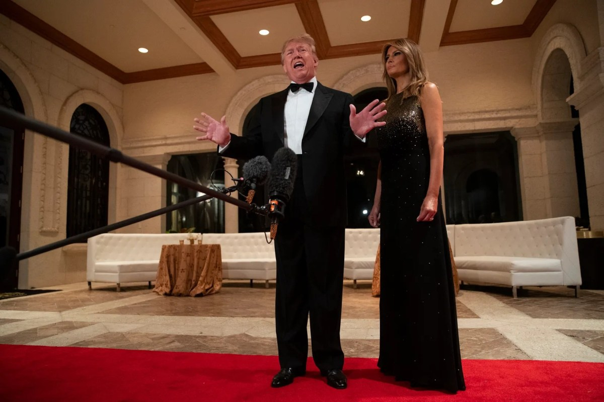 The first lady, Melania Trump, is next to President Donald Trump at her New Year's Eve party at Mar-a-Lago in Palm Beach, Florida on December 31, 2019.