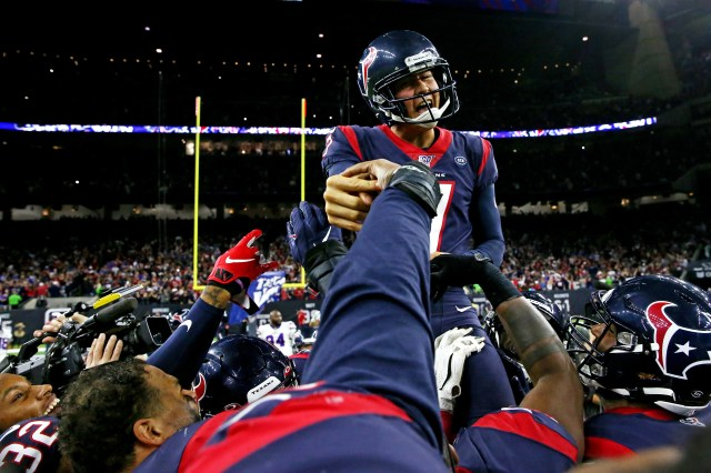 Houston Texans kicker Ka'imi Fairbairn (7) celebrates with teammates after kicking the game winning field goal to beat the Buffalo Bills in the AFC wild-card playoff game at NRG Stadium.