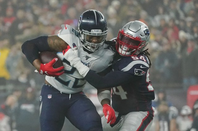 New England Patriots outside linebacker Dont'a Hightower (54) tackles Tennessee Titans running back Derrick Henry (22) during the first quarter at Gillette Stadium.