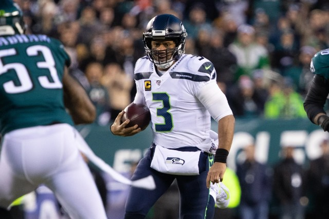 Seahawks quarterback Russell Wilson runs with the ball in the first quarter.