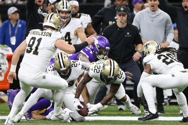 New Orleans Saints strong safety Vonn Bell (24) and defensive back Chauncey Gardner-Johnson (22) try to recover a fumble by Minnesota Vikings wide receiver Adam Thielen (19) during the first quarter of a NFC wild-card playoff game at the Mercedes-Benz Superdome.
