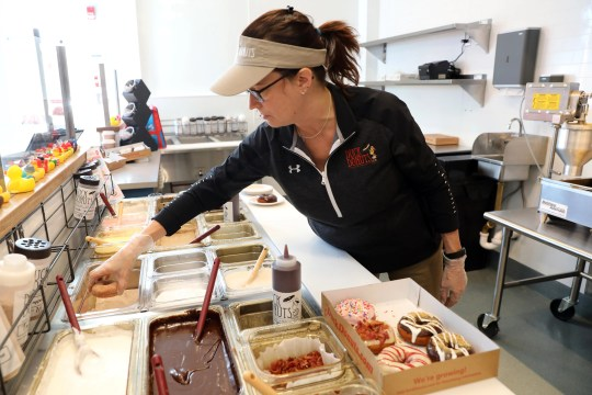 Bonnie Foncello, owner of the new Duck Donuts in Mamaroneck, prepares a cinnamon sugar doughnut Jan. 9, 2020. The Duck, N.C.-based franchise is known for its warm, made to order doughnuts with customizable toppings.