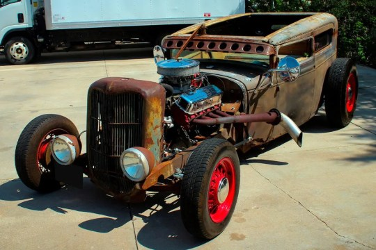 The 1929 Ford Model A coupe comes with a pneumatic suspension, a custom wooden interior, a custom parking brake with ax and a spoke wheelset.