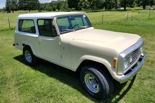 This 1973 Jeep Commando 4x4 features a half cab and a rigid roof complete with new paint and interior. It has half cab and full rigid roof.