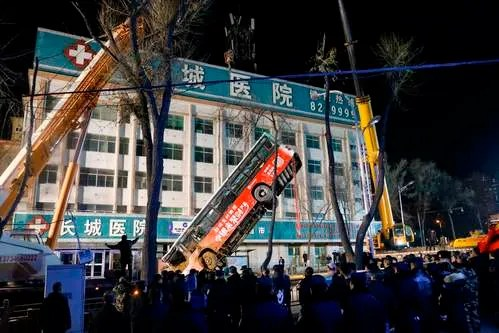 Bus plunges into sinkhole on road in China, killing at least 6 and leaving 4 missing