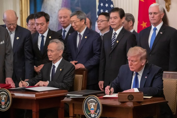 President Donald J. Trump (R) and Chinese Deputy Prime Minister Liu He (L) participate in a signing ceremony for a Chinese trade agreement in the East Room of the White House.