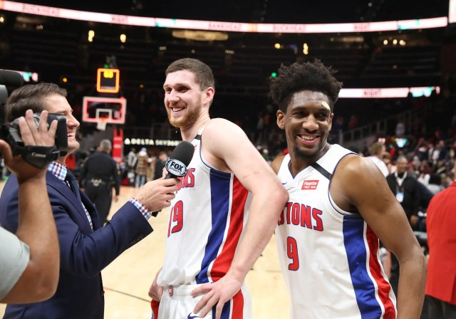 Langston Galloway (9) interrupts an interview for teammate Sviatoslav Mykhailiuk (19) after the win against the Hawks on Saturday.