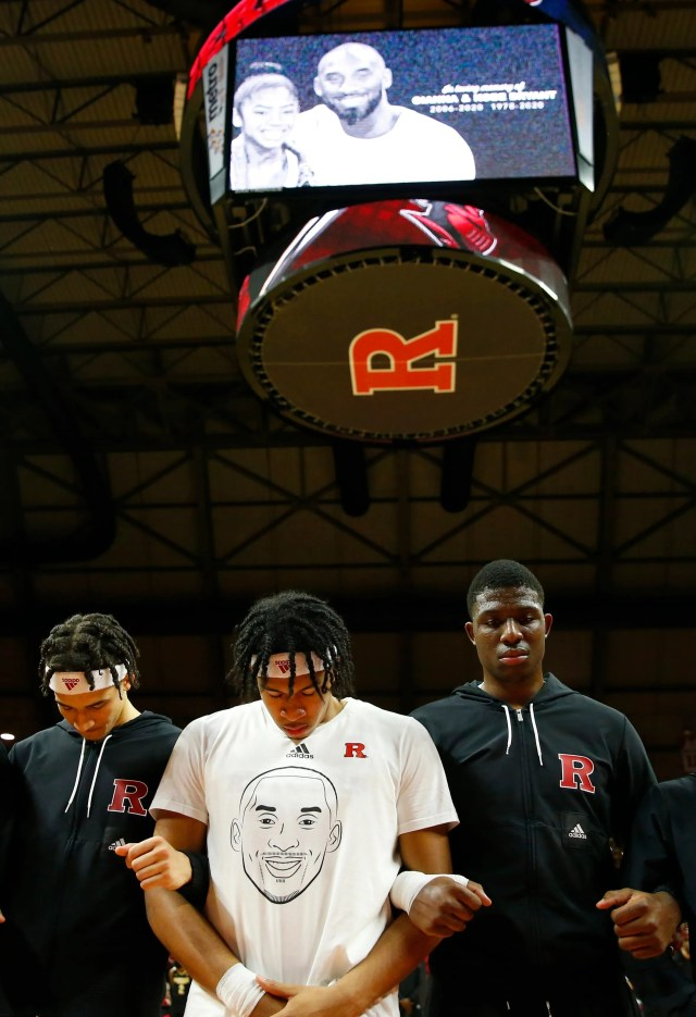Jan 28, 2020; Piscataway, New Jersey, USA; Rutgers Scarlet Knights guard Ron Harper Jr. (24) pauses with teammates during a moment of silence for Kobe Bryant before game against the Purdue Boilermakers at Rutgers Athletic Center (RAC).