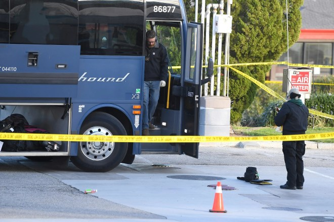 Investigators look for evidence on a Greyhound bus after a passenger was killed on board on Feb. 3, 2020, in Lebec, Calif.