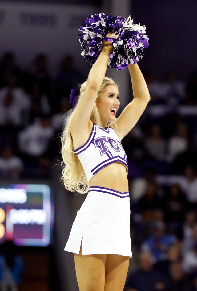Feb. 8: A TCU Horned Frogs cheerleader performs during the second half against the Kansas Jayhawks.