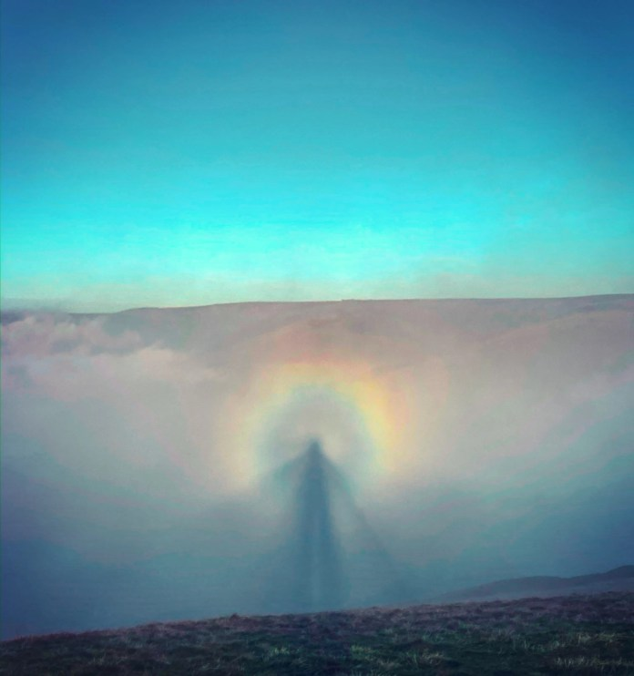 Lee Howdle, a wildlife photographer, captured the divine event known as the Brocken Specter last week in the Peak District National Park in Derbyshire, about 20 miles southeast of Manchester.