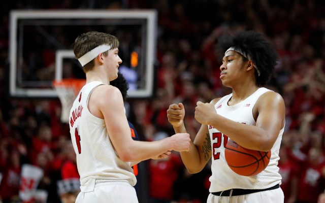 Rutgers Scarlet Knights guard Paul Mulcahy (4) and guard Ron Harper Jr. (24) celebrate after defeating the Illinois Fighting Illini