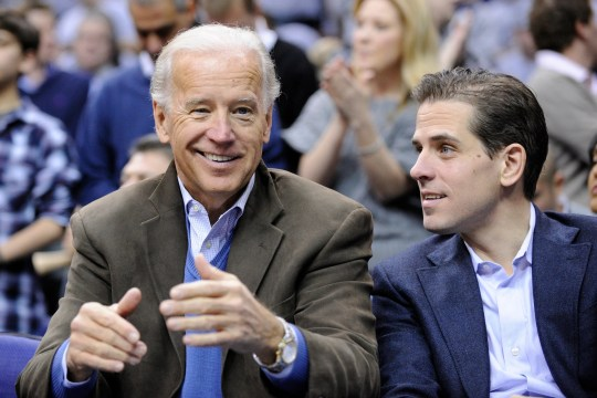 Joe Biden, photographed with his son Hunter at a basketball game in 2010, could face pointed questions about his son's international business interests.