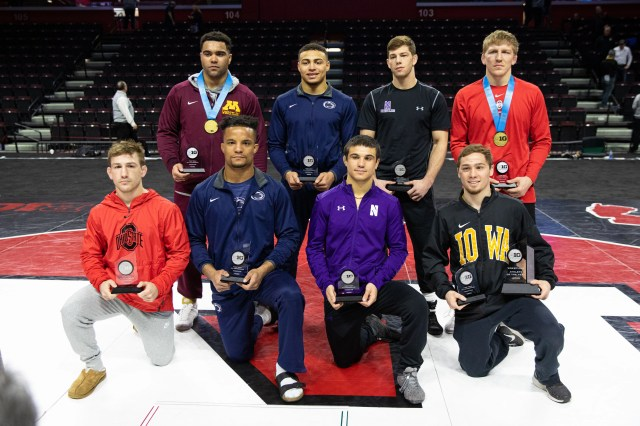 Iowa's Spencer Lee, first row, far right, poses with his trophies after winning his first Big 10 title. Lee was named the conference Wrestler of the Year.
