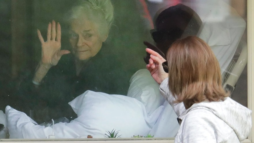 Coronavirus social distancing creates sad reality of window visits