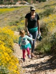 Lisa Nelson of Glendale, hikes with her daughter, Ava Nelson, 2, on a trail at Thunderbird Park in Glendale on March 24, 2020. Hiking trails have been busy as people look to get outside during all the closures because of the coronavirus.