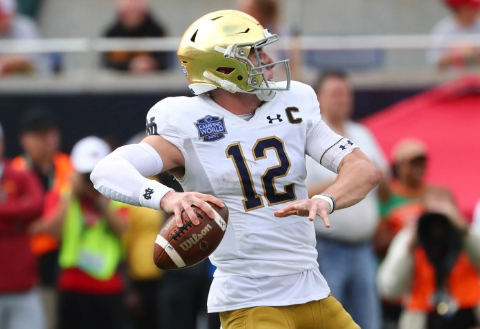 Notre Dame quarterback Ian Book will work with former Irish QB Tommy Rees as the new offensive coordinator.