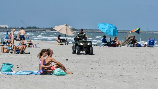 A sheriff's assistant patrols the beach at Cape Canaveral on Saturday afternoon. The county has chosen not to close its beaches between 11 a.m. and 4 p.m. as several municipalities have done because of the coronavirus pandemic.