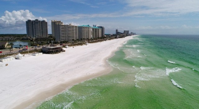The beach in Walton County, Fla sits nearly empty on March 31, 2020 following a mandated closure by the Walton County Commission.
