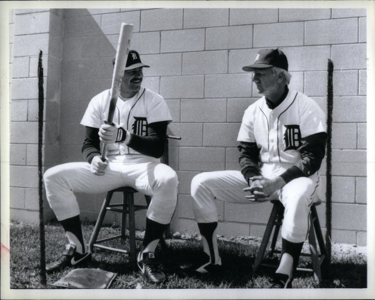 Kirk Gibson chats with past Tigers batter Al Kaline during spring training in March 1986. Gibson, who had a controversial contract dispute with the Tigers during the off-season, was hitting 28 home runs in 1986.