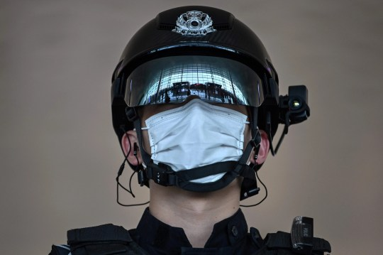 A police officer wearing a face mask stands guard at Tianhe Airport after it was reopened on April, 8, 2020, in Wuhan in China's central Hubei province.