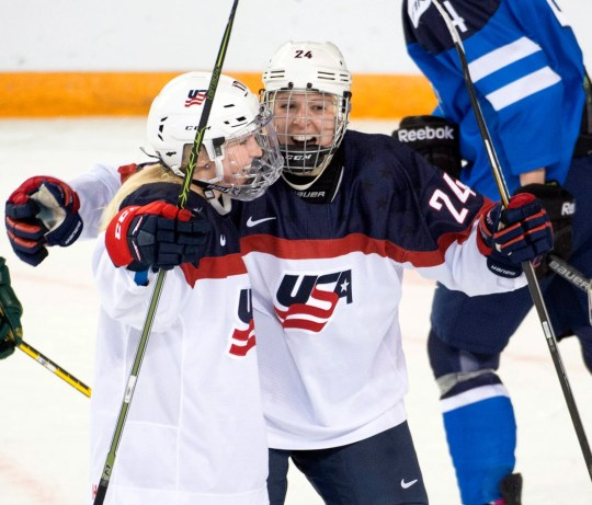 Brighton's Shiann Darkangelo, right, celebrates with Joecelyn Lamoureux-Davidson against Finland during the 2016 women's world hockey championships in Kamloops, British Columbia.