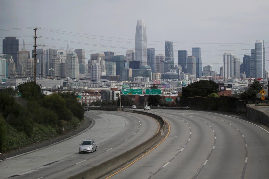Light traffic is seen March 29, 2020, on Highway 101 in San Francisco, amid coronavirus concerns. With most states under stay-at-home orders from governors, traffic is down almost everywhere, and that means lower crash rates and fewer insurance claims. As a result, many auto insurance companies are cutting rates, sending checks or offering credits on monthly bills.