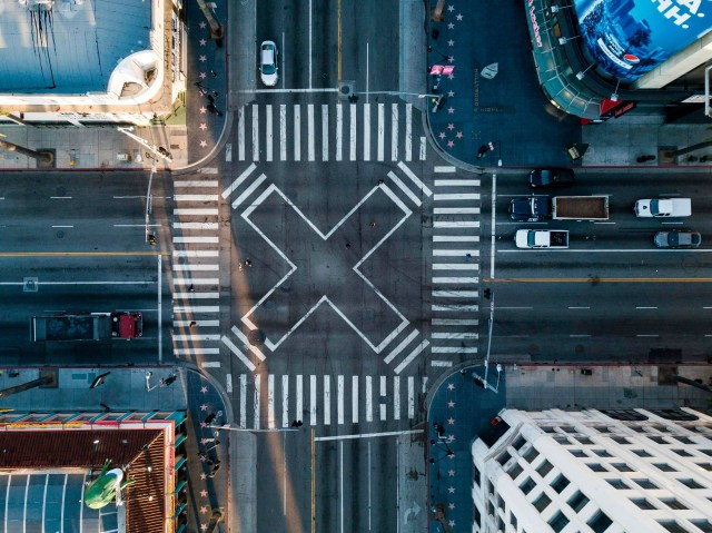 An aerial view at the pedestrian intersection at Hollywood Blvd and Highland Ave during morning rush hour on Monday April 27, 2020 in Los Angeles, California during the coronavirus COVID-19 pandemic.