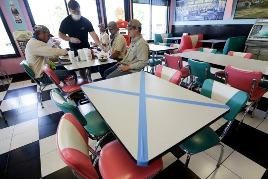 The tables are marked for the social distance to highway 55 Burgers Shakes & Fries, April 27, 2020, in Nolensville, Tennessee.