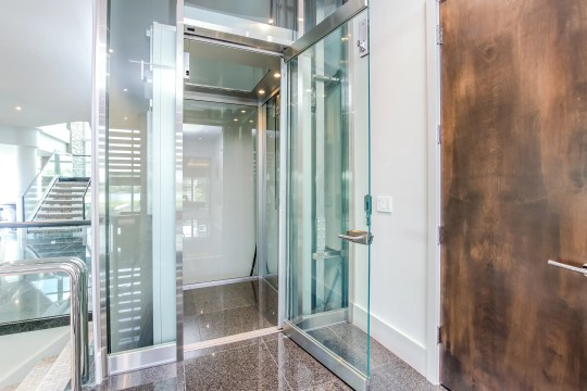 A glass elevator serving the third floor at the home of the Detroit Lions midfielder Matthew Stafford at 1867 Long Pointe Drive in Bloomfield Twp. The house sells for $ 6.5 million. A lakeside palace with five bedrooms, seven bathrooms have 12,295 square feet, including 7,720 above the ground.