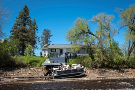 A boat is washed out due to floodwater in the Tittabawassee River in Beaverton, Mich. on Wednesday, May 20, 2020.