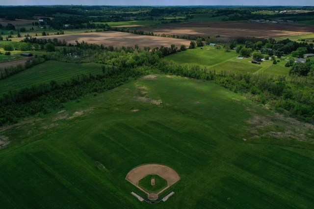 An aerial view of a rural recreational baseball field is seen empty because of lockdowns due to the ongoing coronavirus (COVID-19) pandemic on May 23, 2020 in Hydes, Maryland. While Maryland Gov. Larry Hogan enacted Phase One of reopening Maryland last week, which allowed some businesses such as barbershops and retail stores to reopen with restrictions - sports leagues from youth, recreational, high school, college, and pro all have remained canceled or postponed due to COVID-19.