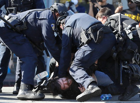 San Jose police subdue a protestor prior to arresting him on Friday, May 29, 2020, in San Jose, Calif.