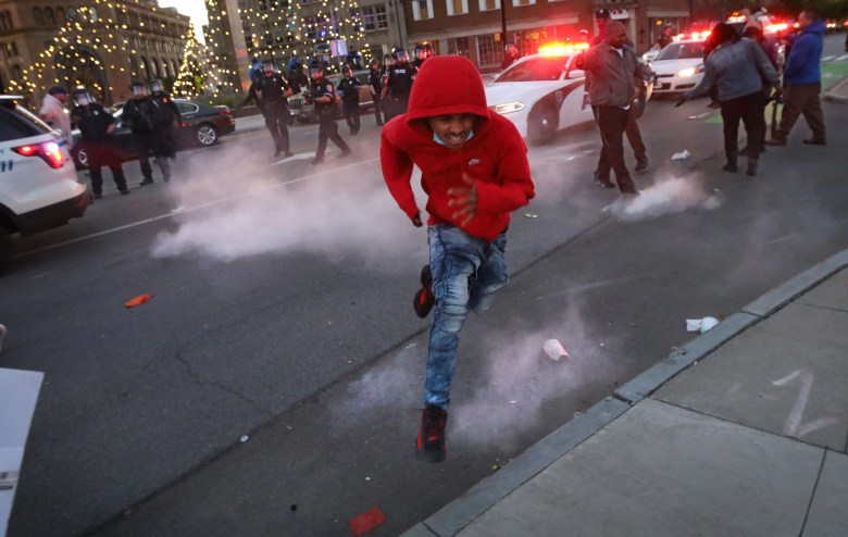 Police use pepper bullets fired at the ground to help disperse protestors near the Liberty Pole and Parcel 5 in downtown Rochester Saturday night, May 30, 2020.  Some on Parcel 5 were throwing rocks at the police.
