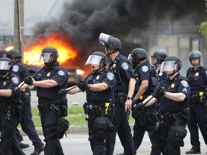 After a Black Lives Matter rally ended in downtown Rochester some protesters destroyed police cars and destroyed cars in a parking lot across from the Public Safety Building on Saturday, May 30, 2020. Cops chanted move back while moving people towards Broad and Exchange.