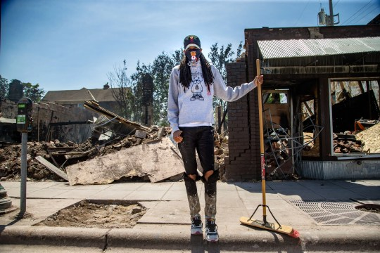 Brandy Moore stands for a photo in front of the rubble of her clothing store Levels Sunday, May 31, 2020. Her Minneapolis business was looted and burned during protests over the death of George Floyd.