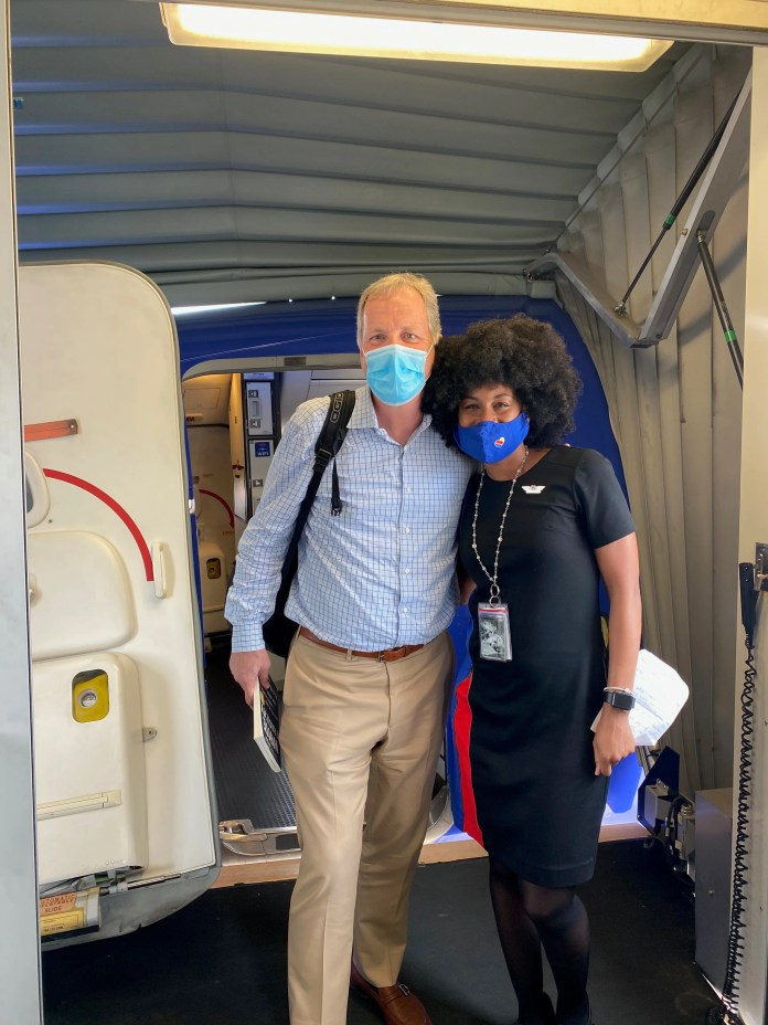 American Airlines CEO Doug Parker and Southwest Airlines flight attendant JacqueRae Hill met on a flight to Panama City, Florida, in May 2020. Hill noticed a copy of a popular book on white privilege in his seatback pocket and struck up a conversation about racism.