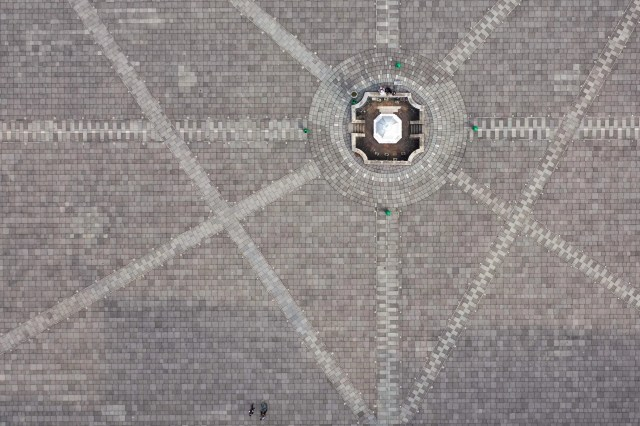This aerial photo shows two people (bottom C) in a deserted square in front of the Fatahillah Museum during a local lockdown due to the COVID-19 coronavirus outbreak in Kota, Jakarta on June 1, 2020.