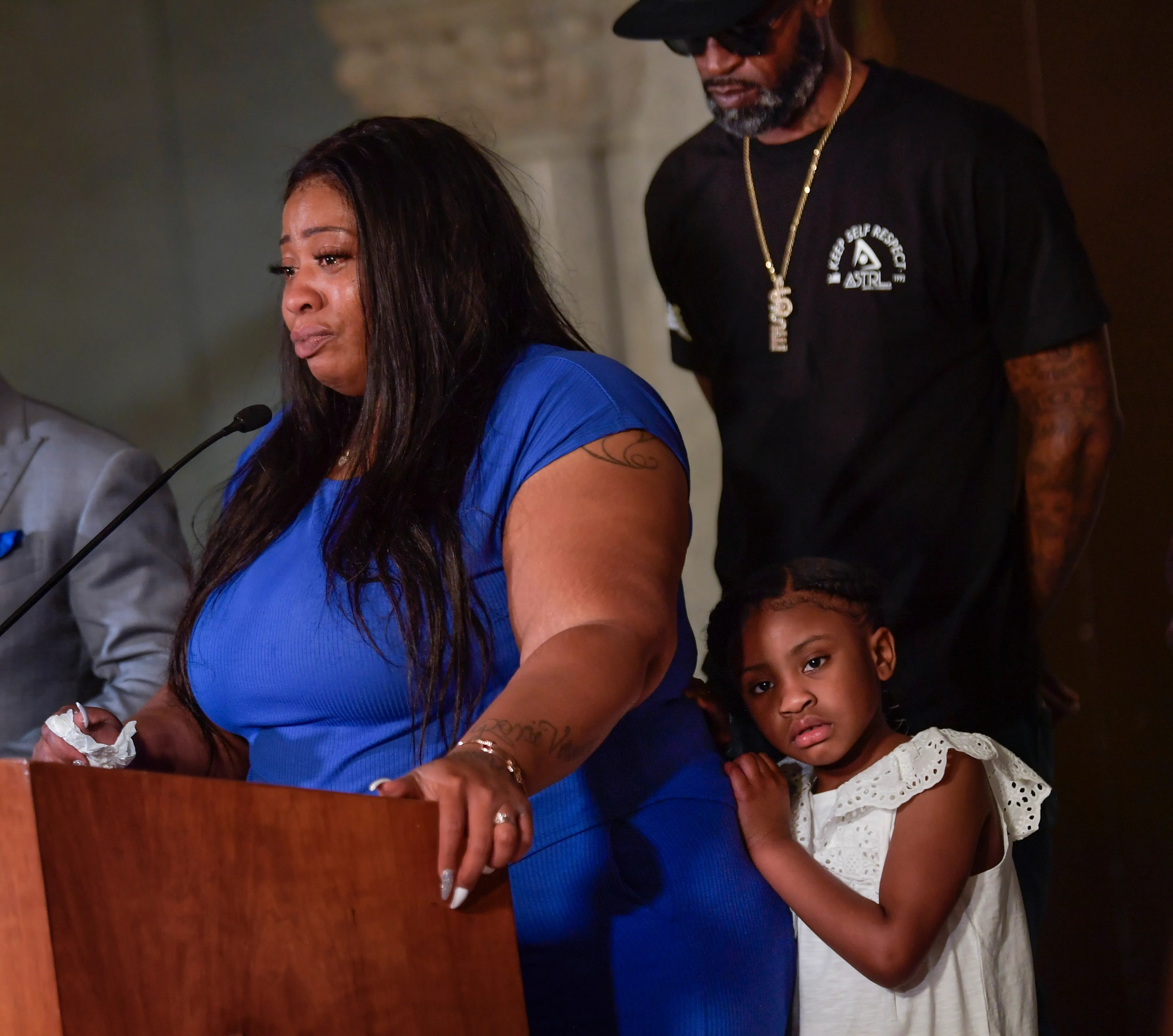 Roxie Washington, the mother of George Floyd's 6-year-old daughter Gianna, center, speaks to the media along with former NBA player, Stephen Jackson, right, a childhood friend of George Floyd, during a press conference at Minneapolis City Hall on Tuesday, June 2, 2020. George Floyd died in Minneapolis police custody on May 25, 2020.