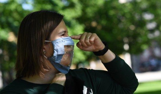 Jessica Oliver of Deaf and Hard of Hearing Services wears a clear-paneled mask on Thursday, June 4, 2020, at Reutter Park in downtown Lansing. The mask makes it easier for people who are deaf and hard of hearing to read lips.