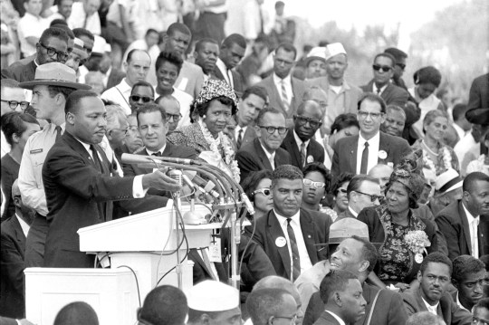 "The Rev. Dr. Martin Luther King Jr., head of the Southern Christian Leadership Conference, gestures during his ""I Have a Dream"" speech as he addresses thousands of civil rights supporters gathered in front of the Lincoln Memorial for the March on Washington for Jobs and Freedom in Washington, D.C., Aug. 28, 1963.  Actor-singer Sammy Davis Jr. can be seen at extreme right, bottom."