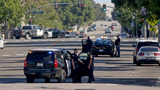 Law enforcement personnel from several jurisdictions patrol Spring Street in Paso Robles, Calif., on Wednesday after an early morning shooting that injured a sheriff's deputy.