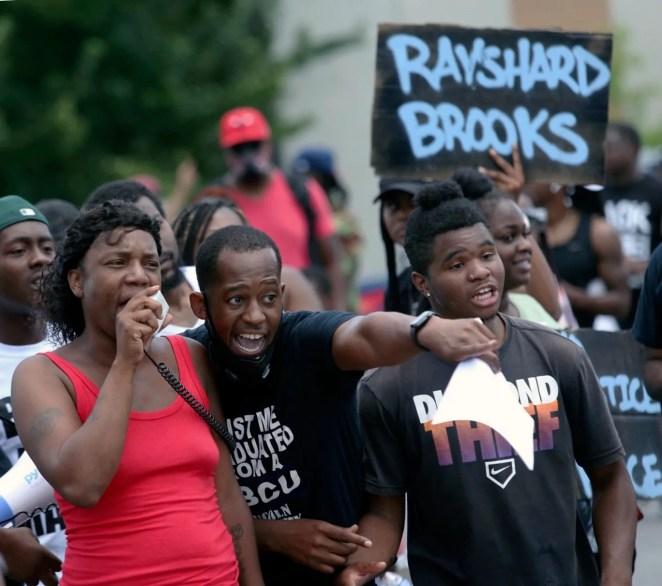 Protestors gather on University Ave near a Wendy's restaurant, Saturday, June 13, 2020 in Atlanta.