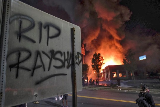 A Wendy's restaurant burns in Atlanta after demonstrators set it on fire Saturday night following the death of Rayshard Brooks, a Black man who was shot and killed by Atlanta police.